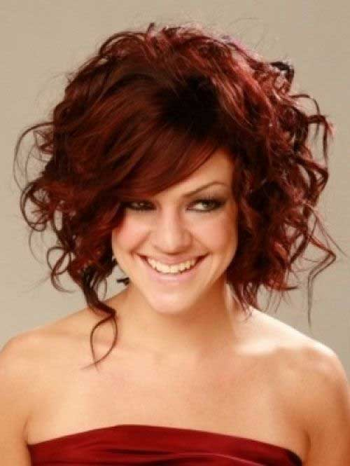 Cute-Dark-Red-Curly-Layered-Hair-with-Side-Bangs Cool Short Red Curly Hairstyle