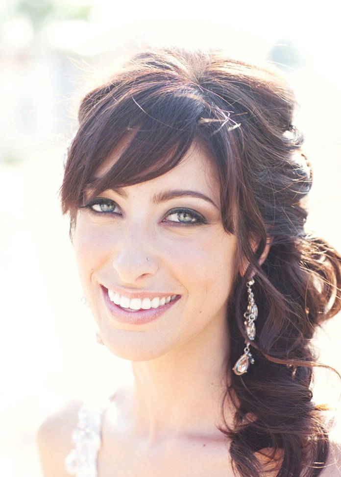 Diagonally-Styled-Front-Bangs-with-a-Curly-Hairdo Most Beautiful Wedding Hairstyles with Bangs