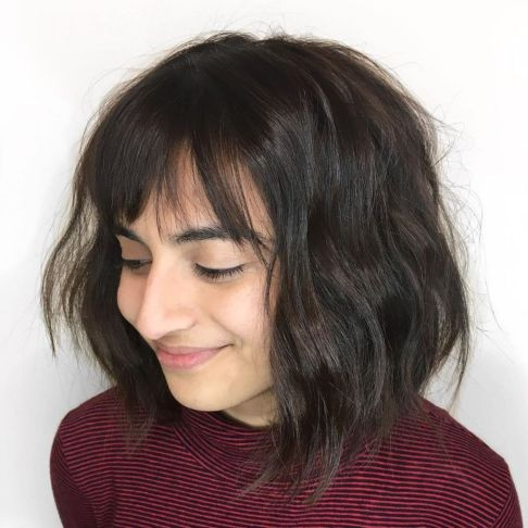 Disheveled-Brunette-Bob-with-Bangs 12 winning looks with medium hairstyles for round face