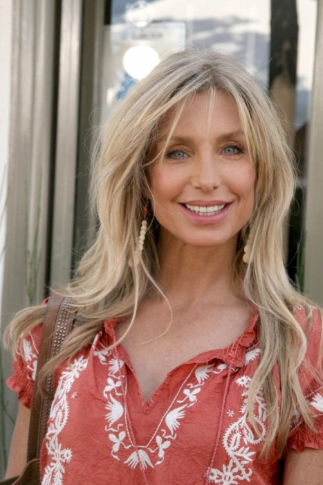 Long-Blonde-Hair-with-Loose-Waves-and-Wispy-Bangs Long Hairstyles for Women Over 50 – Look Trendy And Fashionable