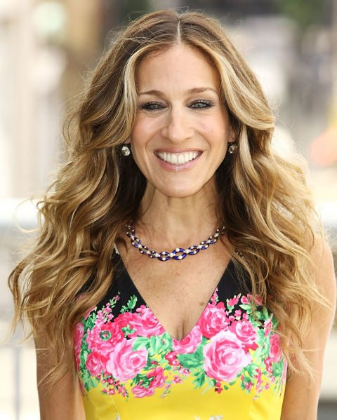 Long-Blonde-Hair-with-Voluminous-Loose-Curls Curly Hairstyles for Women Over 50