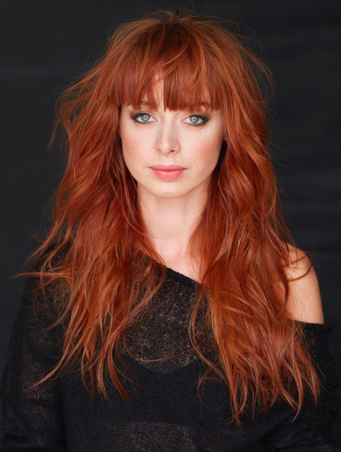 Long-Shag-Haircut-with-Bangs Redhead Hairstyles for Sultry and Sassy Look