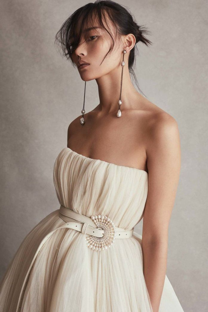Longer-Bangs-with-a-Bun Most Beautiful Wedding Hairstyles with Bangs