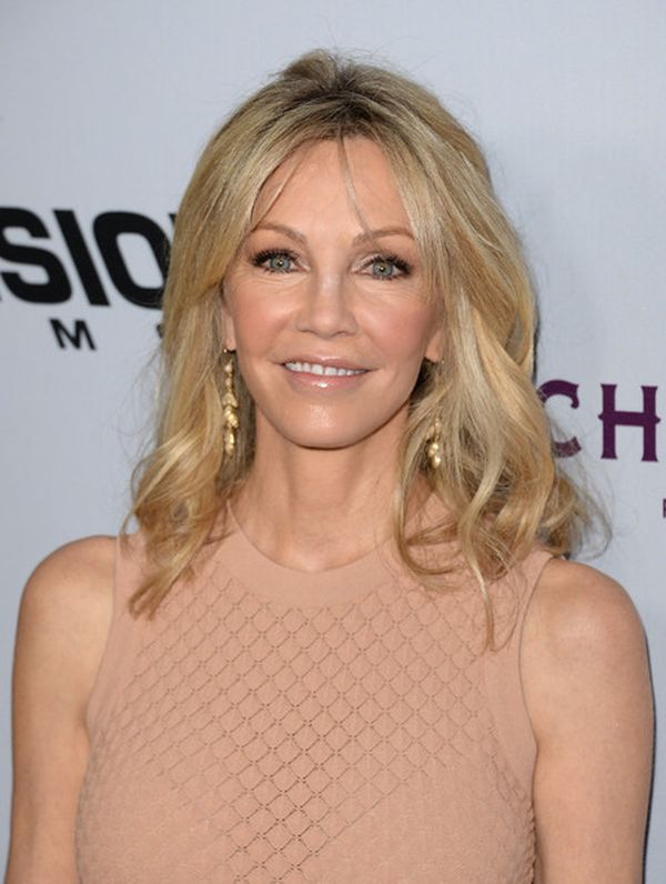 Medium-Blonde-Hair-with-Waves Wavy Hairstyles for Women Over 50 – Look Young And Beautiful