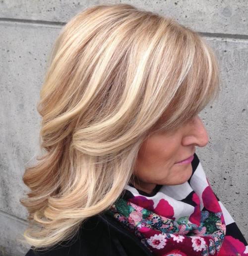 Medium-Wavy-Blonde-Hairstyle Medium Hairstyles for Women Over 50