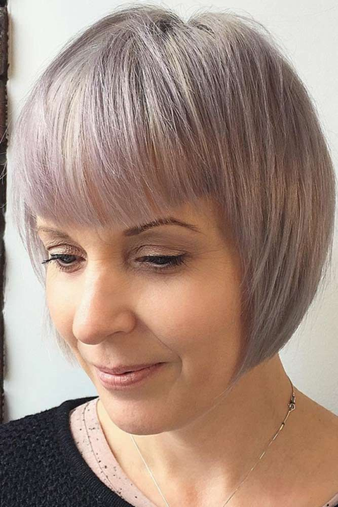 Pastel-Blonde-Bob-with-Bangs Easy Hairstyles for Women Over 50