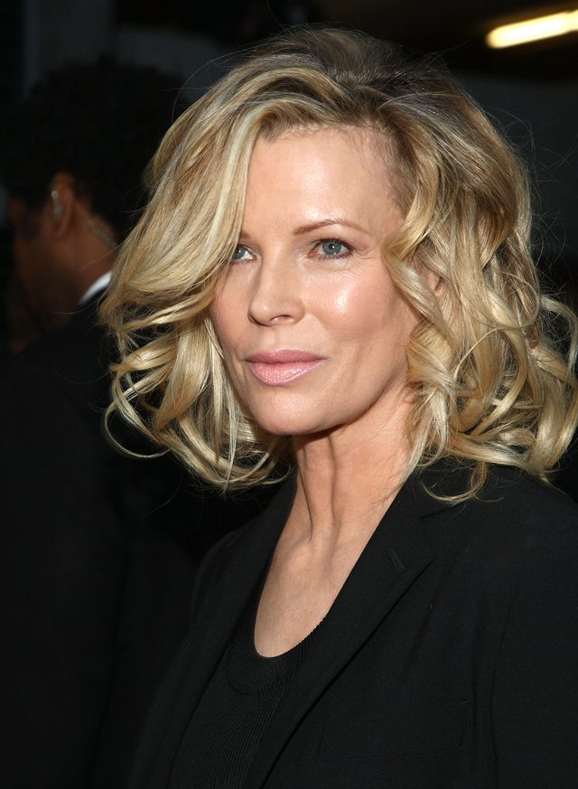 Side-Swept-Blonde-Hair-with-Curls Curly Hairstyles for Women Over 50