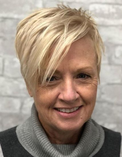 Choppy-Blonde-Pixie-with-Long-Side-Bangs 15 Beautiful pixie cuts for older women
