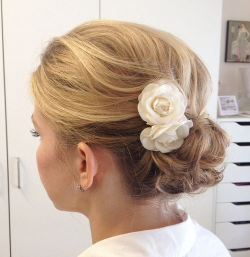 Curly-Bun-with-Hair-Flowers Quick and Easy Short Hair Buns to Try