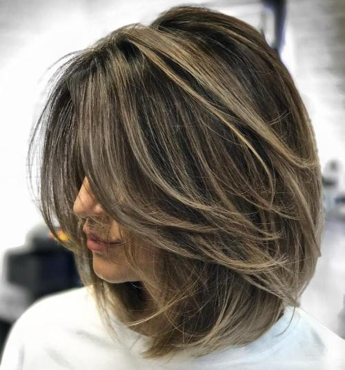 Feathered-Brunette-Lob-Cut 12 Winning-looks Layered Bob Hairstyles
