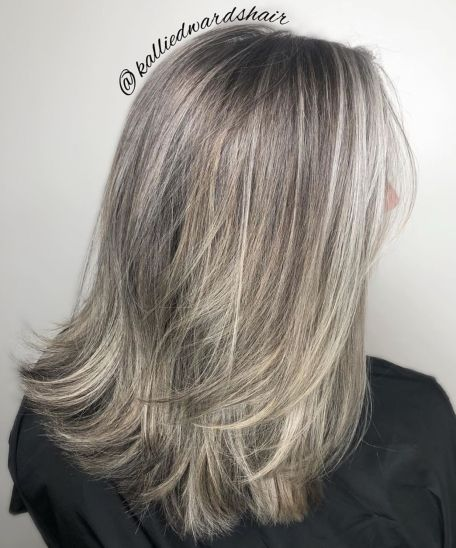 Medium-Cut-with-Feathered-Ends 14 Stylish Gray Hair Styles for older women