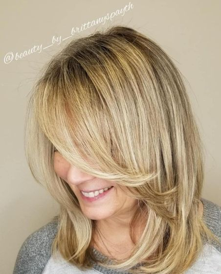 Medium-Cut-with-Long-Feathered-Bangs 15 winning-looks short hairstyles for Women Over 40