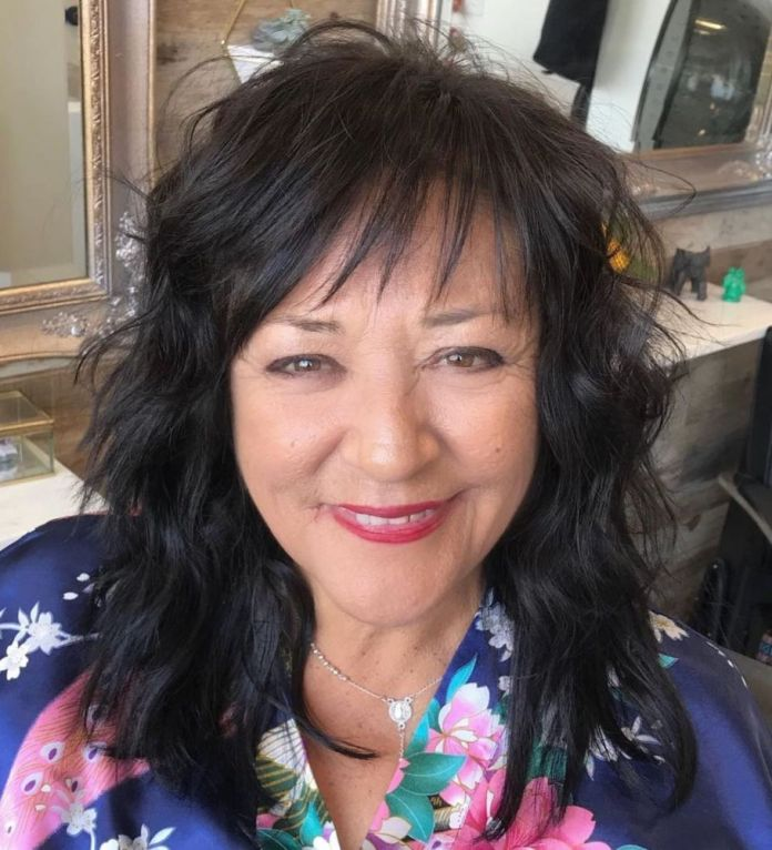 Wavy-Hairstyle-with-a-Razored-Fringe Shaggy Hairstyles for Women with Fine Hair over 50