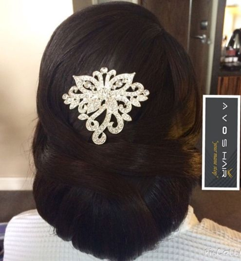Accessorized-Low-Bun-for-a-Black-Bride 14 Flattering Black Wedding Hairstyles