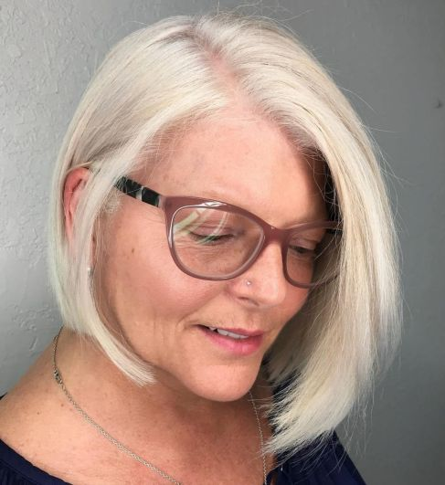 Asymmetrical-Bob-Tucked-Behind-the-Ear 10 Flattering and Stylish Hairstyles for Women over 50 with Glasses