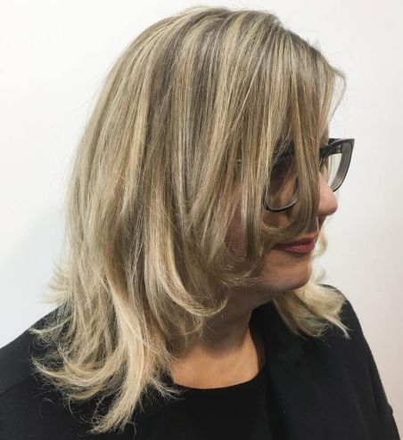 Face-Framing-Layered-Haircut-for-50-Year-Olds 10 Flattering and Stylish Hairstyles for Women over 50 with Glasses