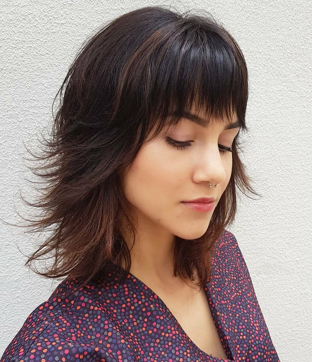Feathered-Bob-with-Bangs Cute Medium Length Hairstyles to Glam Up Your Look