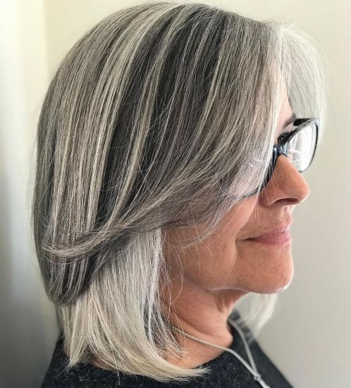 Gray-Lob-with-Long-Parted-Bangs 10 Flattering and Stylish Hairstyles for Women over 50 with Glasses