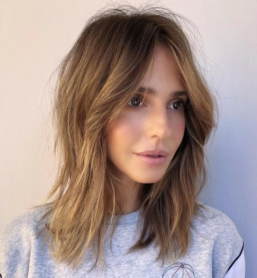 Medium-Shag-with-Curtain-Bangs. 12 On-trend Hairstyles for Oval Faces You'll be dying to try!