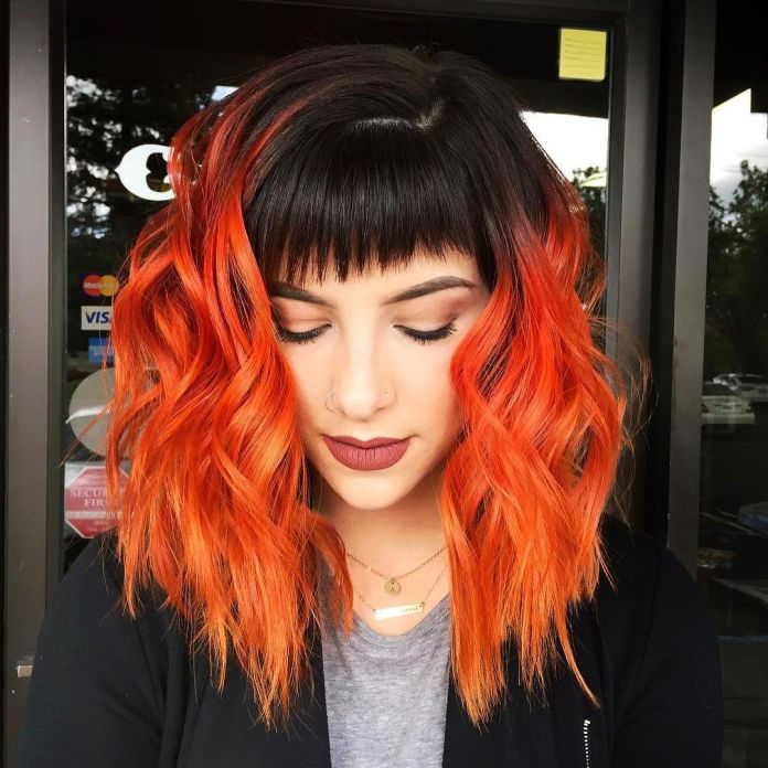 Fiery-Orange-Hair-with-Black-Roots Most Coolest Medium Hairstyles with Color