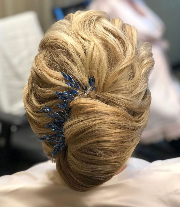 French-Roll-with-a-Barrette. 15 Beautiful Hairstyles for Mother of The Bride That's Easy To Put Together