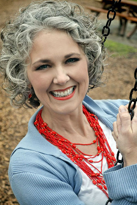 Grey-Curls Best Short Curly Hairstyles for Women Over 50