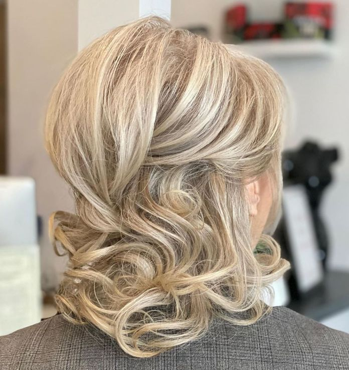 Loose-Half-Updo 15 Beautiful Hairstyles for Mother of The Bride That's Easy To Put Together