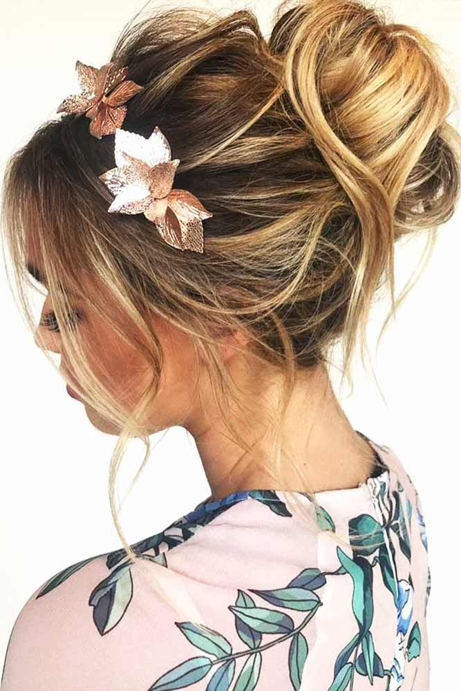 Two-Toned-Balayage-Messy-Bun-with-a-Floral-Accessory Messy Bun Hairstyle is the New Style to Enhance Your Look