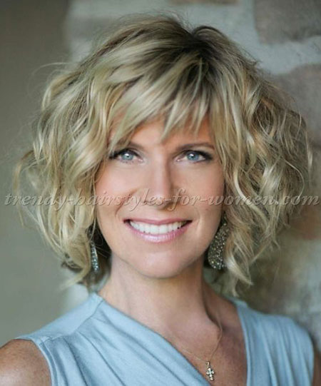 Wavy-Hair-with-Side-Bangs Best Short Curly Hairstyles for Women Over 50