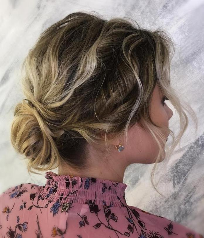wavy-bun-with-side-twists 20 Eye-catching Updo Hairstyles To Make Your Day