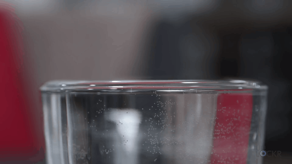 Water Molecules Clinging At The Top Of A Glass