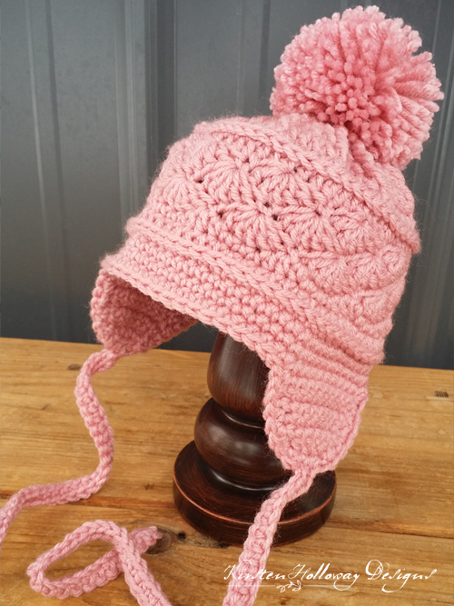 La Vie en Rose Earflap Hat by Kirsten Holloway Designs | Part of a FREE Crochet Hat Pattern Round up on The Unraveled Mitten