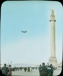 Photograph of a Biplane Flying by the Column of Progress at the Panama-Pacific International Exposition, 1915. Local ID: 16-SFX-28.