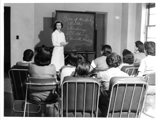 "513-AS Image is captioned: ""Inservice education for non-professional personnel, Navajo Medical Center"""