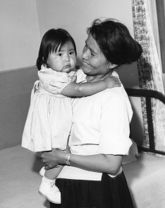 """Navajo Family living outside Window Rock, visiting PHS Indian Hospital, Ft. Defiance, AZ."" (513-AS)"