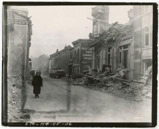 "111-SC-200481 ""Bomb damage, the result of a German ten-day siege."" Photo taken 12/26/1944"