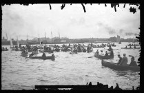 77-SOO-U-19: Large Party of Canoes In St. Marys River, Celebrating Some Unidentified Event, ca. 1900s-1910s. [Emulsion damage is evident around the edges of the negative where the photographic information has been lost, appearing as black defects in the positive.]