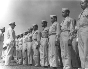 """The thirty smartly disciplined members of ""Squadron 10"", first colored unit to report for navigation training at Hondo Army Air Field, Hondo, Texas, are shown being inspected shortly after their arrival at the huge navigation airbase. The inspecting officer is Captain Frank H. Sheffield. At his left is Navigation Cadet Arnold W. Galimers, flight marcher for the colored group. "" (342-AM-173976)"