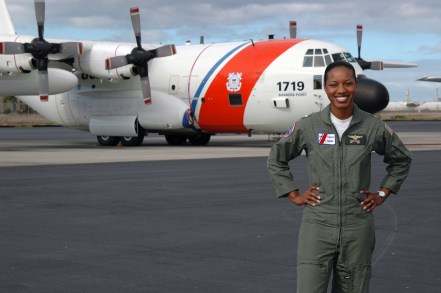 """U.S. Coast Guard LT. j.g. Jeanine McIntosh, Pilot, the first female African-American to successfully complete flight training, stands in front of a U.S. Coast Guard HC-130H Hercules patrol aircraft on Jan. 2, 2006, that she will pilot on service missions throughout the Pacific region, while stationed at Coast Guard Air Station Barbers Point, Oahu, Hawaii. (U.S. Coast Guard photo by Public Affairs SPECIALIST 2nd Class Jennifer Johnson) (Released)."" Date Taken: January 2006 (Local ID: 330-CFD-DD-SD-07-24603)"