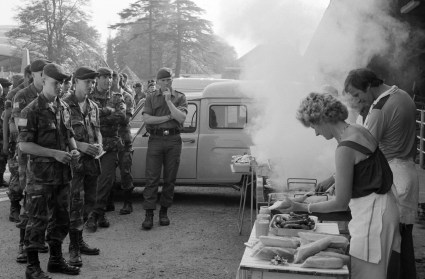 "(Local Identifier: 330-CFD-DA-SN-86-008543) ""Members of the 82nd Airborne Divison attend a cookout in their honor while visiting the town. They are in France to participate in the 40th anniversary celebration of D-day, the invasion of Europe."""