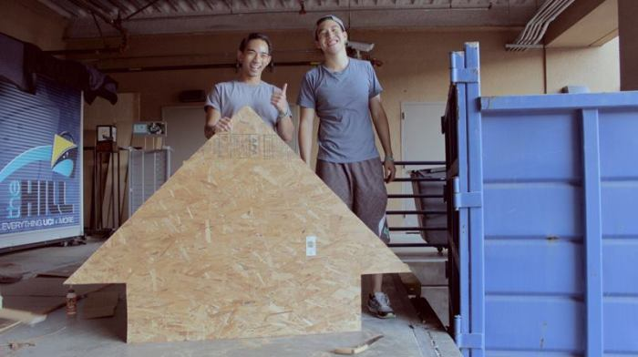 David and Justin posing with half of the UP Arrow.