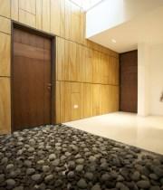 Natural grovels Sleek marble floor High gloss finish door Laminate wall