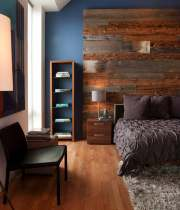 contemporary-bedroom-blue-wall-paint-rustic-wood-headboard-brown-bedlinen-pillows-desklamp-nightstand-chair-bench-book-rack-cherry-wooden-laminate-flooring-smooth