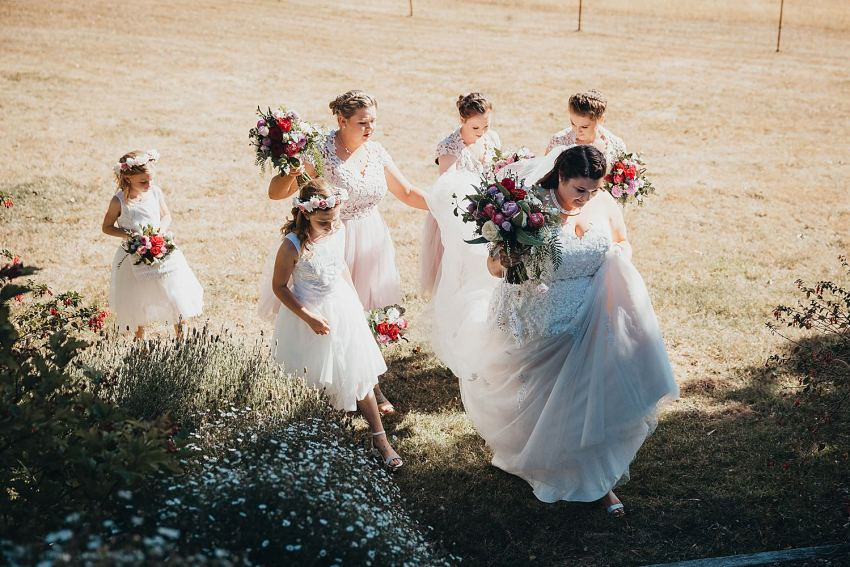 Bridal party walking up the steps after the ceremony at Mt Macedon Winery