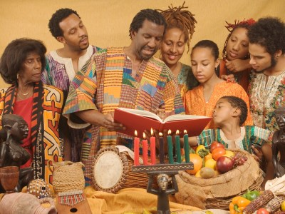 Family lighting candles celebrating Kwanzaa