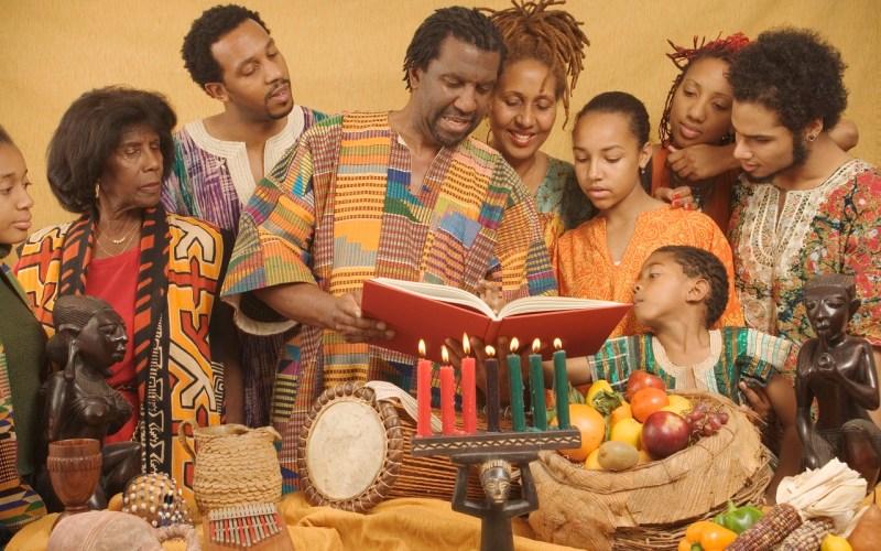 Family lighting candles celebrating Kwanzaa