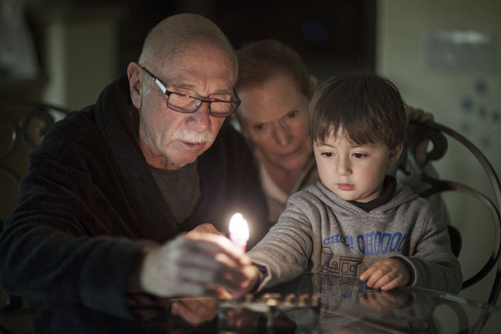 family lighting candles