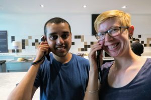 Sarah The Urban Wanderer and Jit listening to their audio tour on the audio wands - grinning like nutters!