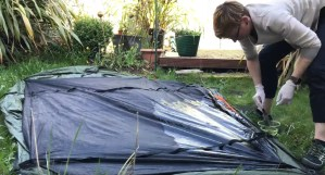 Me reproofing the tent in the garden