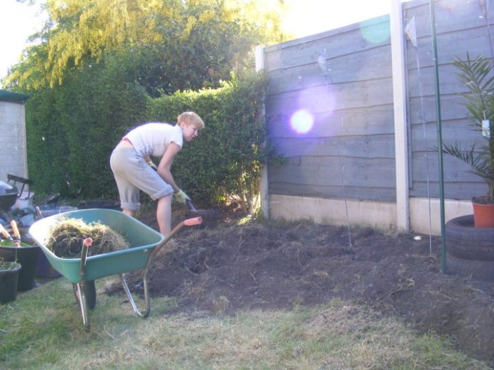 Me shovelling lots of top soil in the garden for At Home with the urban wanderer